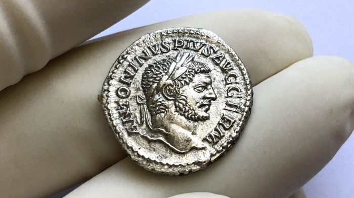 Roman Empire - Caracalla (198-217 AD).Denarius. Rome. Jupiter on throne crowning Nike. Superb