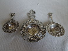 3 x Dutch silver tea strainers, one large with sailing ship and 2 pieces with floral and bird decoration