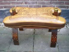 Nicely decorated saddle stool for a camel
