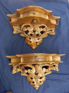 A pair of Rococo style gilt wood consoles with drawers, circa 1900