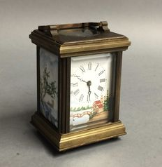 Small brass carriage clock with porceain -- Period: 21st century