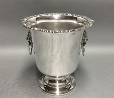 Silver plated champagne cooler on short foot, with two lion heads, England, ca. 1940