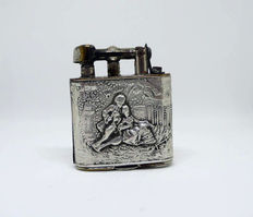 Chromed metal petrol lighter and body carved in Silver (830 contrast) - c.1910