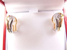 A pair of very chic bi-color gold 18 ct  gold earrings set with brilliant cut diamonds, Europe twentieth century.
