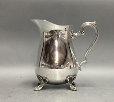 Silver plated water jug on claw feet, England, ca 1935