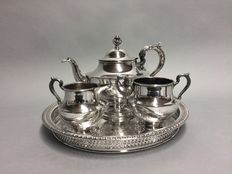 Silver plated tea set on a round serving tray, U.S.A, ca. 1945