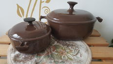 Two cast iron pots and pans by Le Creuset