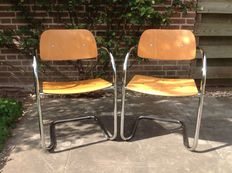 Unknown manufacturer, two designer lounge chairs