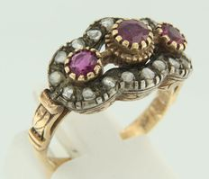 Gold ring, ruby with rose cut diamonds set in silver.
