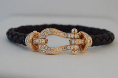 Leather bracelet with 18 karat rose gold clasp with diamonds