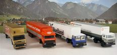 Lion Car - Scale 1/50 - Lot with 4 models: 4 x DAF truck's and trailers, Bleu Band, Van Gent & Loos, Continental & Twix