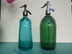 Two very decorative siphons/syphons, Seltzer bottles.