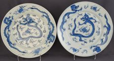 Plates decorated with dragons and a flaming pearl, marked with six characters – Japan – 19th century