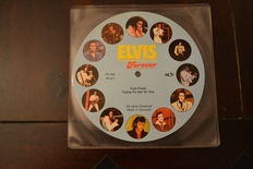 """9.  7"""" singles from the king of rock and roll, Elvis Presley"""