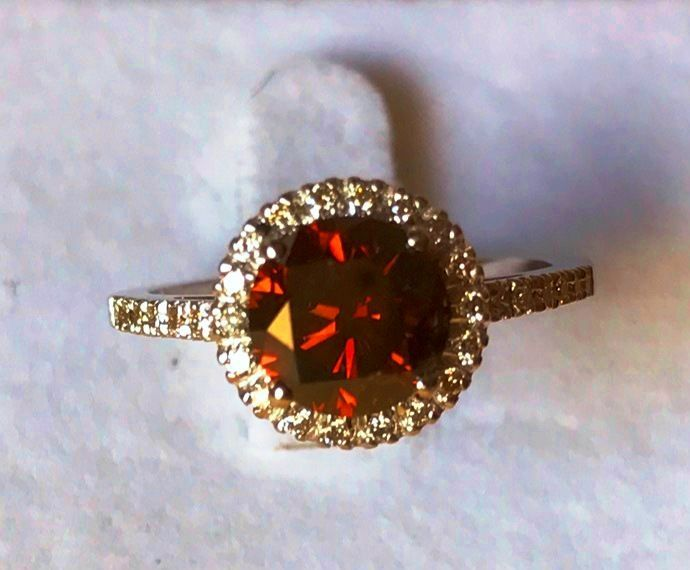 2.37 ct Diamond Ring – centre brilliant diamond of 2.14 ct,fancy Red Orang Si2– side diamonds totalling 0.23 ct.