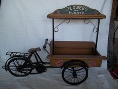 "Beautiful old flowers and plants cargo bike with inscription  ""Flowers and plants""."