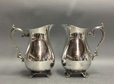 Two silver plated water jugs, England, period 1930