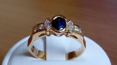 Gold ring with blue sapphire and diamonds