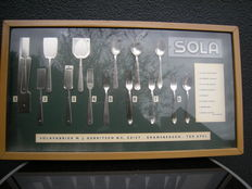 The history of Sola cutlery in show display case length 66 cm