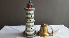 Decorative ship's bell and lighthouse