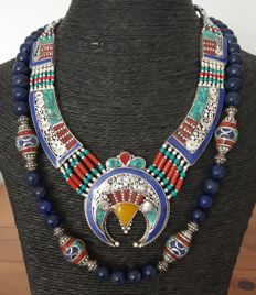 Two Tibetan style necklaces inlaid with coloured coral, turquoise and lapis lazuli paste. Stamped 925