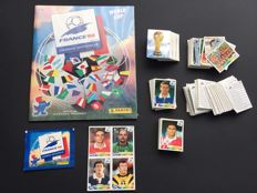 Panini-World Cup France 98 - Complete loose set + empty album in original seal + Pack + Extra sticker sheet.