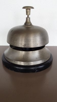 Large/heavy hotel or counter bell - on a wooden base.