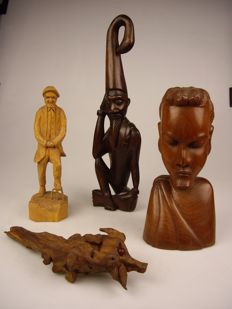 A collection of 4 wood carved products