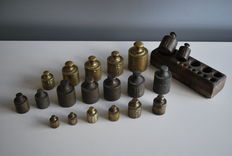 Antique brass button weights, total 20 pieces with 1 wood block