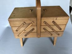 Extendable wooden sewing box on legs with dovetail joints at the corners
