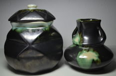 Thulin earthenware lidded pot and a vase, both with Airain glaze