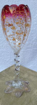 Beautiful antique decorated glass with a twisted foot with gold leaf on it.