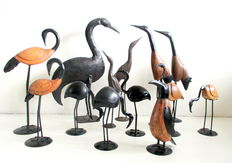 Lot of 13 upright wrought iron birds including a pinguin