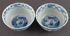 Set of two cups with contoured edge with decorations of seated figure in garden landscape – China – Circa 1730, Yongzhen period (722-1735)