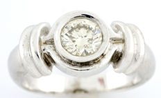 White gold (18 kt) cocktail ring set with a central brilliant-cut diamond of 0.74 ct. (IGE certificate)
