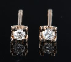 14 kt rose gold solitaire ear studs set with brilliant cut diamond, approx. 0.12 carat in total
