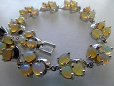 Silver bracelet with natural fire opal, rhodium.