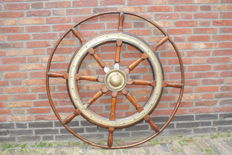 Teak wood ship's helm with an active brass banding and brass Baas end 1800