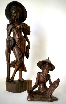 Two Coromandel wooden sculptures of a girl and a bare-chested man – Bali – Indonesia