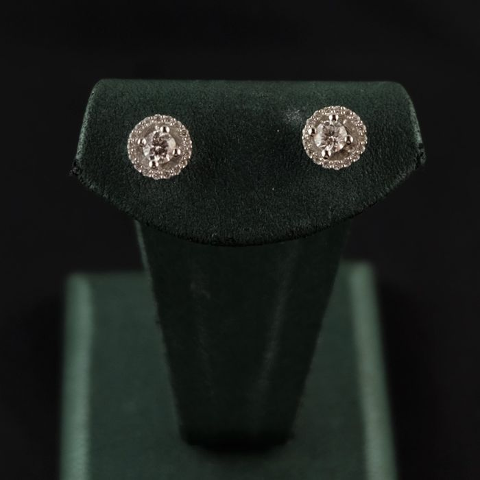 0.54 ct H/VS1, 18 kt / 750 white gold earrings, 2.00 g, with special wearing option