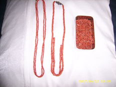 2 red coral necklaces, 1 with gold clasp and 1 with silver clasp and a box with separate red corals.