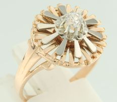 18 kt bi-colour gold ring with a central Bolshevik abrasives shape cut diamond total of approximately 0.22 carats