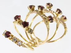 Strapped bundle of five rings with white and brownish red stones - 1930