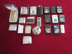 21 lighters including Dunhill, Mylflam Ball, Ronson and Zippo. 1st and 2nd half of 20 century.