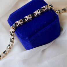 Beautiful vintage bracelet with large oval cut natural Sapphires approx. 8 Ct. and small old cut diamonds.