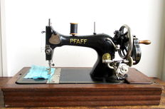 Beautiful Pfaff type 11 sewing machine decorated with golden ornaments and original wooden hood / key - first half of 20th century
