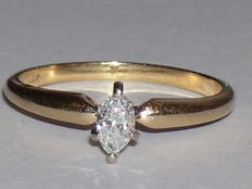 14 karat yellow gold ring with marquise cut diamond (0.25 ct). Ring size 15.8 mm.