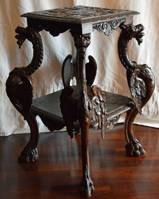 Historicism, 19th century, walnut wood, small table with sculptures of dragons, end of 19th century.