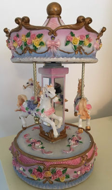 Beautiful pastel-coloured carousel music box which plays ' Lara's theme from doctor Zhivago '