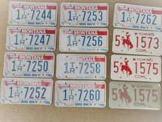 12 American license plates - Montana (truck) and Wyoming (commercial) mostly like new - late 20th century